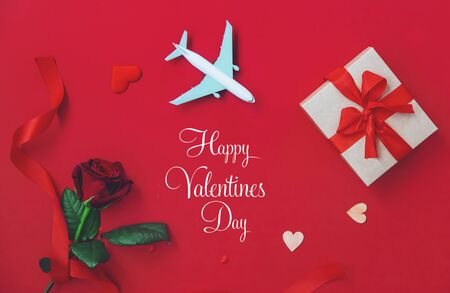 Beautiful red background happy Valentines day plane. Selective focus. Holiday.