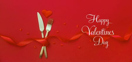 Romantic dinner for Valentines day on a red background. Selective focus. Holiday.