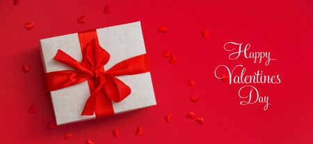 Gift on a red background. Selective focus. Holiday. Stock Photo
