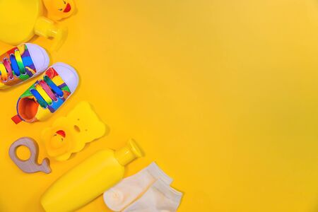 Accessories for newborns on a yellow background. Selective focus. Baby.