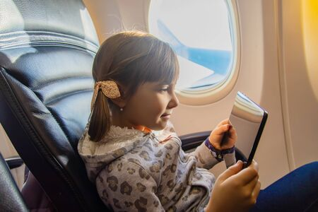 A child is flying in an airplane. Selective focus.