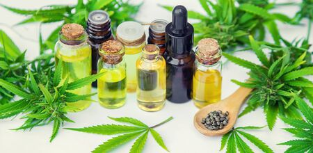 Cannabis oil in a small bottle. Selective focus. nature. Stock Photo