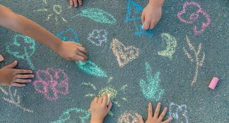 Children's drawings on the asphalt with chalk. Selective focus. nature.