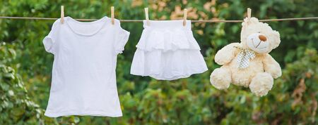 White clothes dry on a rope in the summer. Selective focus. nature.