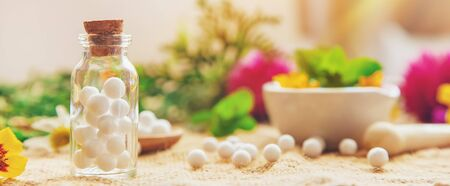 Homeopathy. Herbal extracts in small bottles. Selective focus. nature.