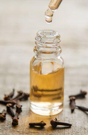 Clove essential oil in a small bottle. Selective focus. nature. Standard-Bild
