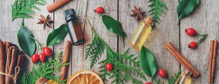 Christmas essential oils in a small bottle. Selective focus. Holiday. Stock Photo