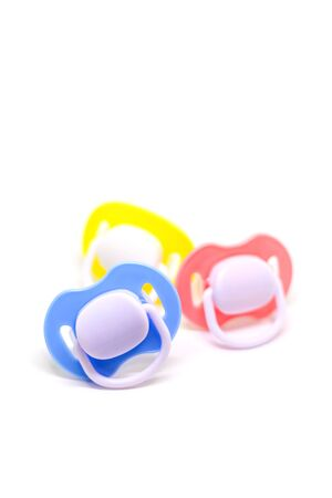 Dummy pacifiers for newborns in different colors. Selective focus. baby.