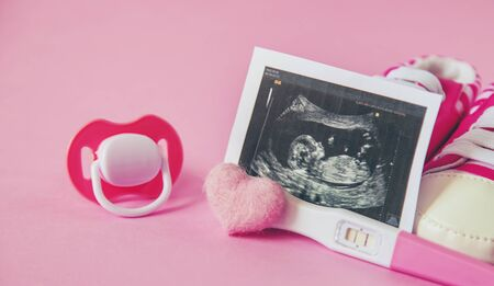 Ultrasound picture of a baby's photograph and accessories. Selective focus. child.