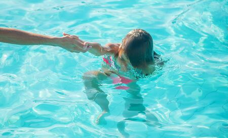 kid is drowning in the sea. Selective focus. nature. Stock Photo