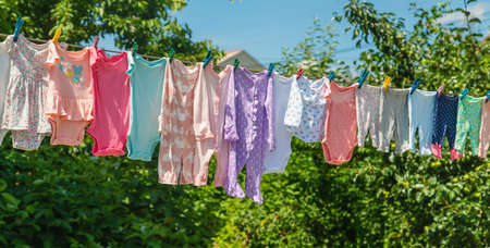 Baby clothes are drying on the street. Selective focus. nature. 스톡 콘텐츠 - 152306135
