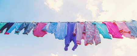 Baby clothes are drying on the street. Selective focus. nature.