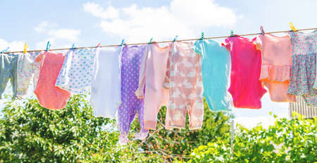 Baby clothes are drying on the street. Selective focus. nature. 스톡 콘텐츠 - 152306147
