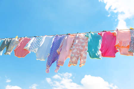 Baby clothes are drying on the street. Selective focus. nature. 스톡 콘텐츠 - 152306149