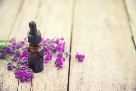 Lavender essential oil in a small bottle. Selective focus.nature. 스톡 콘텐츠 - 152341155