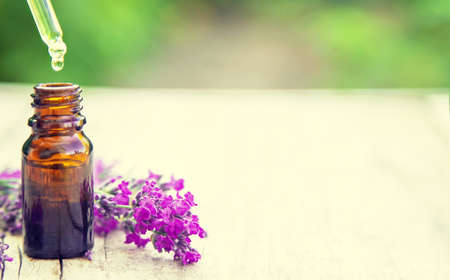Lavender essential oil in a small bottle. Selective focus.nature. 스톡 콘텐츠 - 152339837