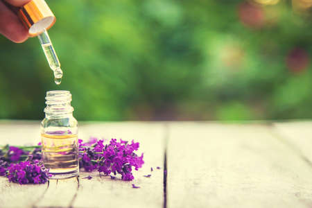 Lavender essential oil in a small bottle. Selective focus.nature. 스톡 콘텐츠 - 152340094