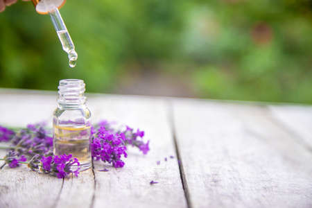 Lavender essential oil in a small bottle. Selective focus.nature.