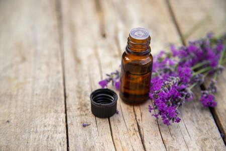 Lavender essential oil in a small bottle. Selective focus.nature. 스톡 콘텐츠 - 152339857