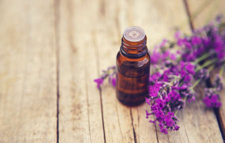Lavender essential oil in a small bottle. Selective focus.nature. 스톡 콘텐츠 - 152340141