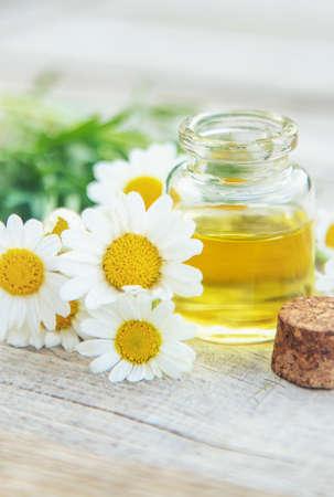 Chamomile essential oil in a small bottle. Selective focus. nature. Archivio Fotografico