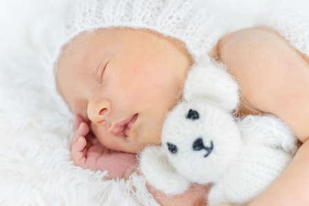 Newborn baby sleeps in a hat. Selective focus. people.