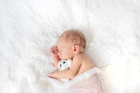 Newborn baby sleeping on a white background. Selective focus. people. 版權商用圖片