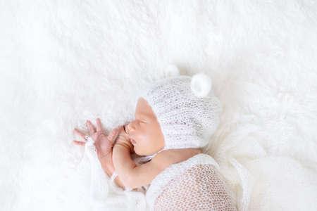 Newborn baby sleeps in a hat. Selective focus. people. Standard-Bild