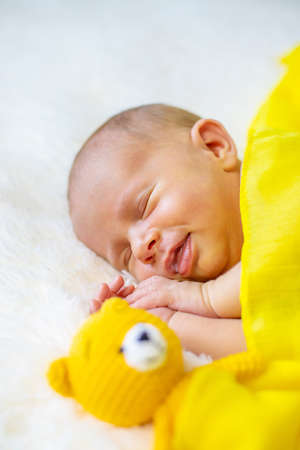Newborn baby sleeping on a white background. Selective focus. people.