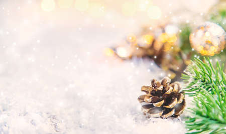 Christmas decor, pine cones in the snow. Selective focus. Holiday.
