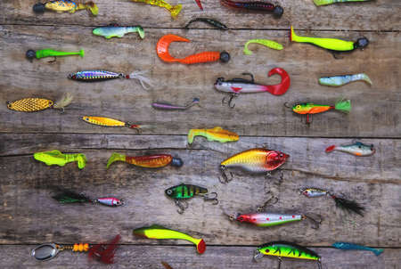 accessories for fishing on a wooden background. selective focus. fishing.