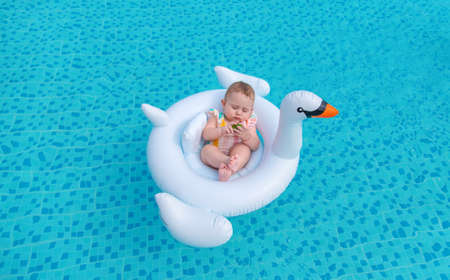 Baby swims in a circle on the sea. Selective focus. Child. Stockfoto
