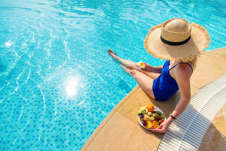 Girl near the pool with fruits. Selective focus. People. Stockfoto