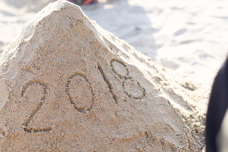 2018 New Year image on the beach sand