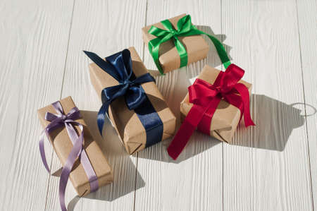 Top view of various gift boxes on wooden table. Christmas gift boxes on wooden table. Stock Photo