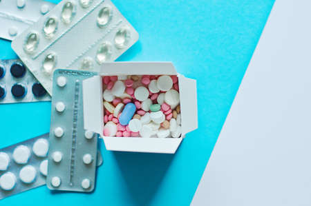Box of medicine as a pharmacy delivery. Online shopping and medicine delivery concept. Capsules, tablets in basket. Health care, pharmacy shipping. Reklamní fotografie