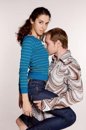 The guy holding his girlfriend  Фото со стока