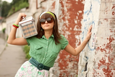 Girl with a suitcase in the glasses in restro image photo