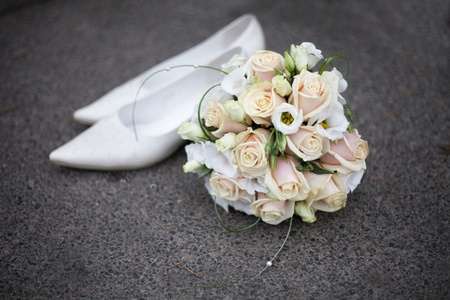 Wedding background from bouquet and white shoes bridge photo