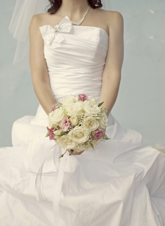 Bride in a white dress with a wedding bouquet photo