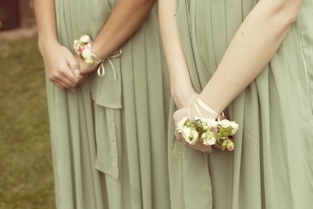witnesses: Hands of the witnesses to the wedding bouquets