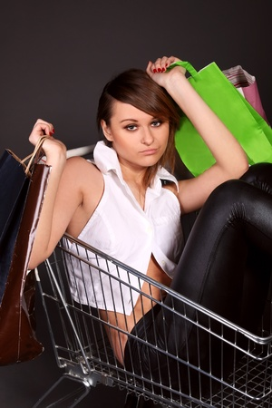 woman in the shopping cart with shopping bags Stock Photo - 9291050