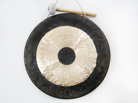 antique dishes: gong with hammer  Stock Photo