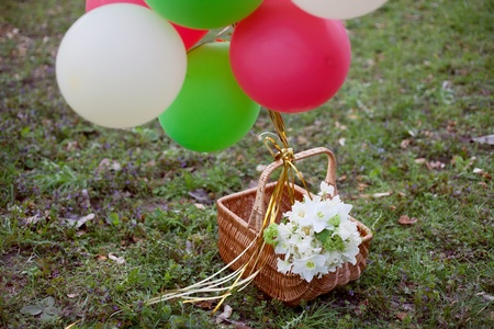 white bridal bouquet and balloons in the basket photo