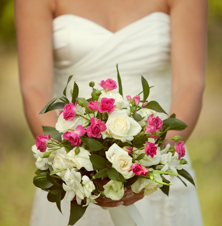 bridal bouquet: pink and white wedding bouquet of roses in the hands of the bride Stock Photo