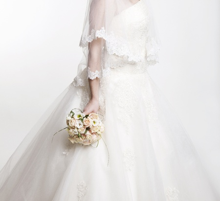 pretty dress: pink and white wedding bouquet of roses in the hands of the bride Stock Photo