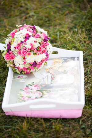 pink and white wedding bouquet in delicate tones on the grass Stock Photo