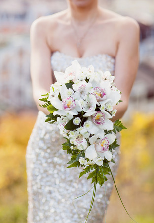 White Lily Wedding Bouquet In The Hands Of The Bride Stock Photo ...