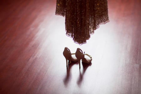 silver shoes and wedding dress photo