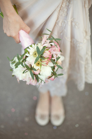wedding bouquet: pink and white wedding bouquet of roses in the hands of the bride Stock Photo
